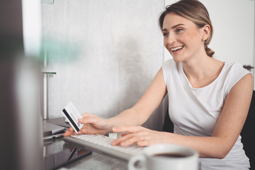 beautiful-happy-woman-holding-credit-card-hand-using-laptop-computer-keyboard-businesswoman-entrepreneur-working-online-shopping-e-commerce-internet-banking-spending-money-concept